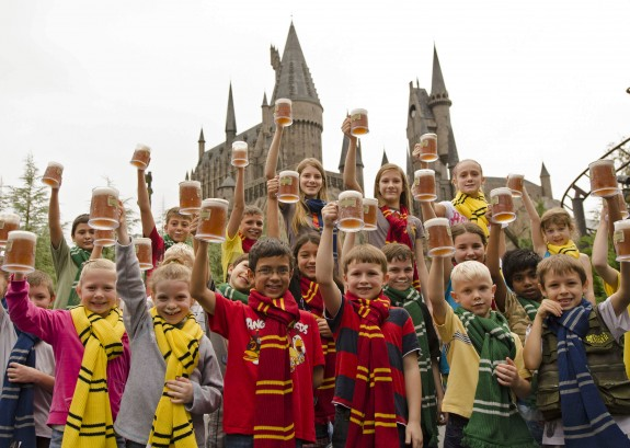 Photo of children holding up butterbeer mugs at Universal Orlando