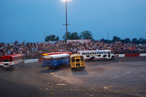 School buses race in a figure 8 crashing into each other