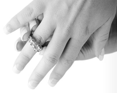 black and white photo of diamond ring being placed on finger