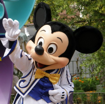Mickey Mouse waves to visitors