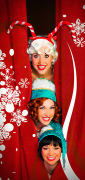 Elves playfully peek from the opening curtain at Capone's during the holidays